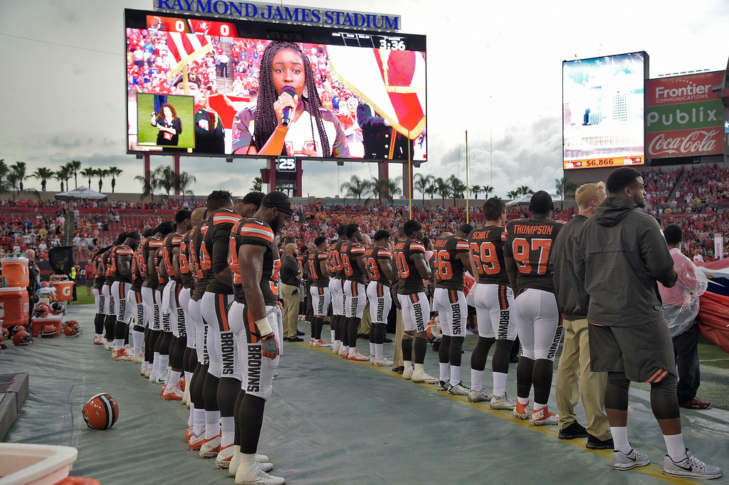 . Cleveland Browns during the playing of the national anthem before an NFL preseason football game against the Tampa Bay Buccaneers Saturday, Aug. 26, 2017, in Tampa, Fla. (AP Photo/Phelan M. Ebenhack)