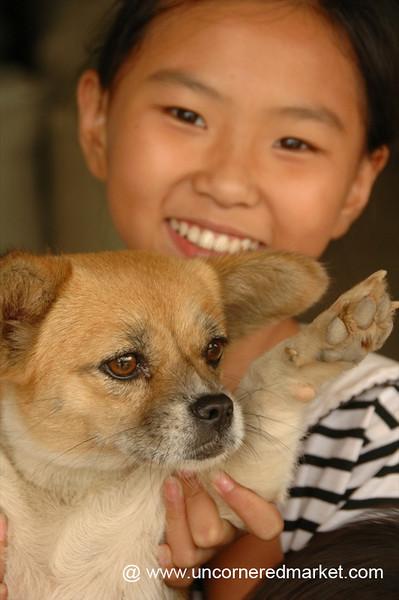Chinese Girl and Her Dog - Xishuangbanna, China