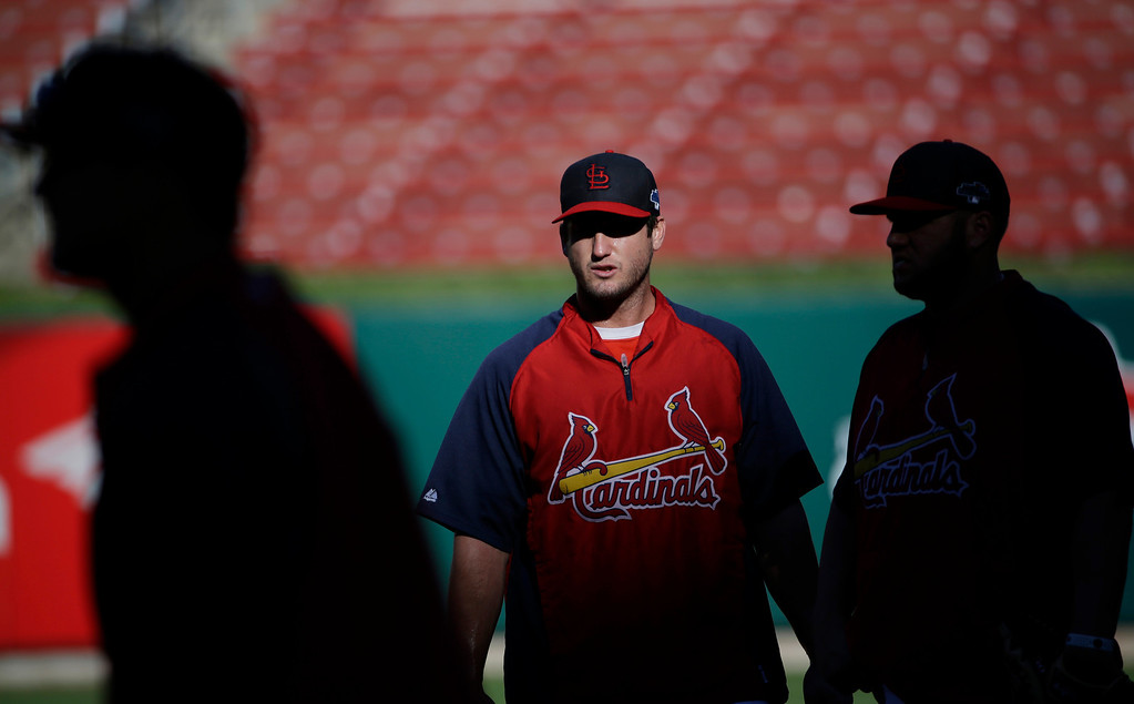 . St. Louis Cardinals third baseman David Freese warms up before Game 1 of the National League baseball championship series against the Los Angeles Dodgers Friday, Oct. 11, 2013, in St. Louis. (AP Photo/David J. Phillip)
