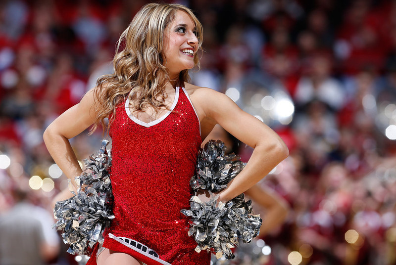 . A Temple Owls cheerleader performs during a game stoppage in the first half against the Indiana Hoosiers during the third round of the 2013 NCAA Men\'s Basketball Tournament at UD Arena on March 24, 2013 in Dayton, Ohio.  (Photo by Joe Robbins/Getty Images)