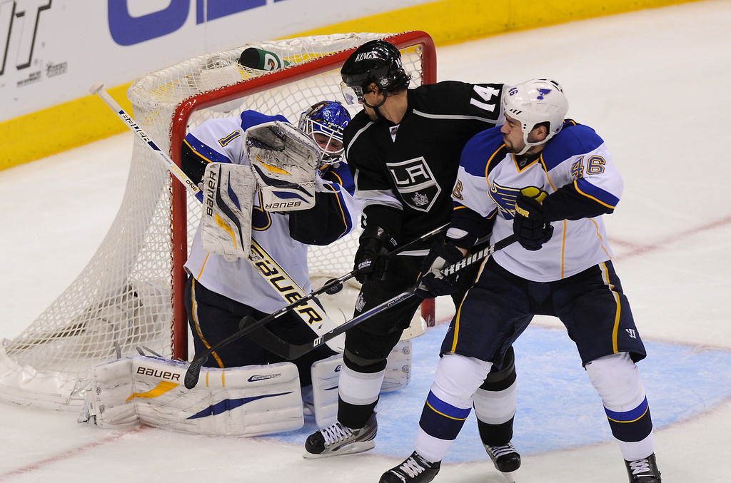 . The Kings\' Justin Williams scores the winning goal off an assist from Mike Richards between St. Louis Blues goalkeeper Brian Elliott and Roman Polak in the third period, Monday, May 6, 2013, at Staples Center. (Michael Owen Baker/Staff Photographer)