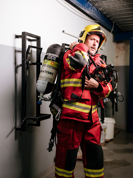 Rudy Fassin direct response crew (professional firefighters) with his gear in the hangar on the French side - Samuel Zeller for the New York Times