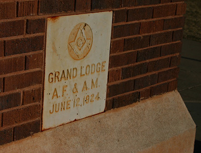 """As evidenced by the cornerstone, the old high school was dedicated on June 12, 1924.  Prior to that time, Spearfish elementary and secondary students took their classes on the campus of the old normal school, now Black Hills State University.   Interestingly, in 1925 the major classroom building at the normal school burned, so college classes were also conducted in the new school building -- along with elementary and secondary classes.  It truly was a """"consolidated"""" school!  It had been some 43 years that  Spearfish was without its own stand-alone high school."""