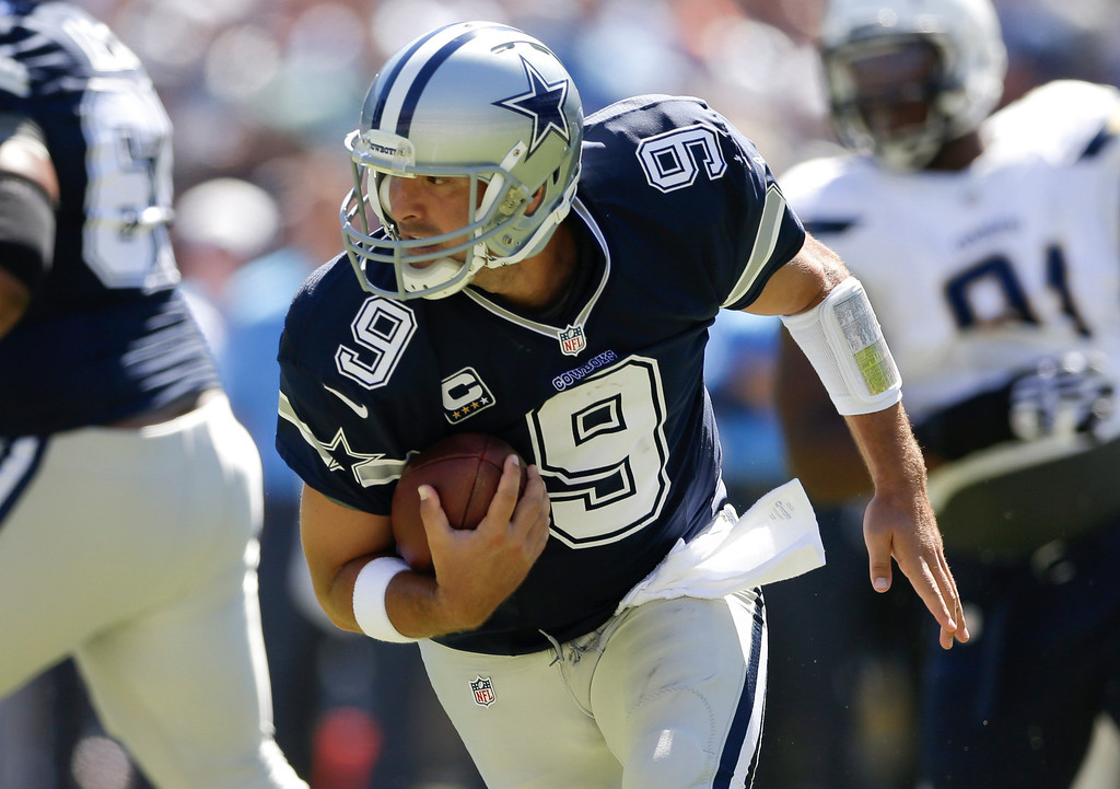 . Dallas Cowboys quarterback Tony Romo runs the ball against the San Diego Chargers of an NFL football game Sunday, Sept. 29, 2013, in San Diego. (AP Photo/Gregory Bull)