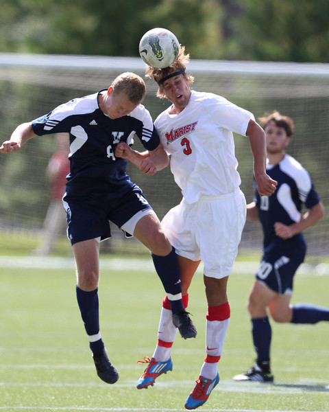 POUGHKEEPSIE, NY - SEPTEMBER 23: Marist Red Foxes Simon Laugsand #3 heads ball during Yale verses Marist Soccer on September 23, 2012 at Tenney Stadium in Poughkeepsie New York.  Yale defeats Marist 2-1. (Photo by Sandy Tambone)
