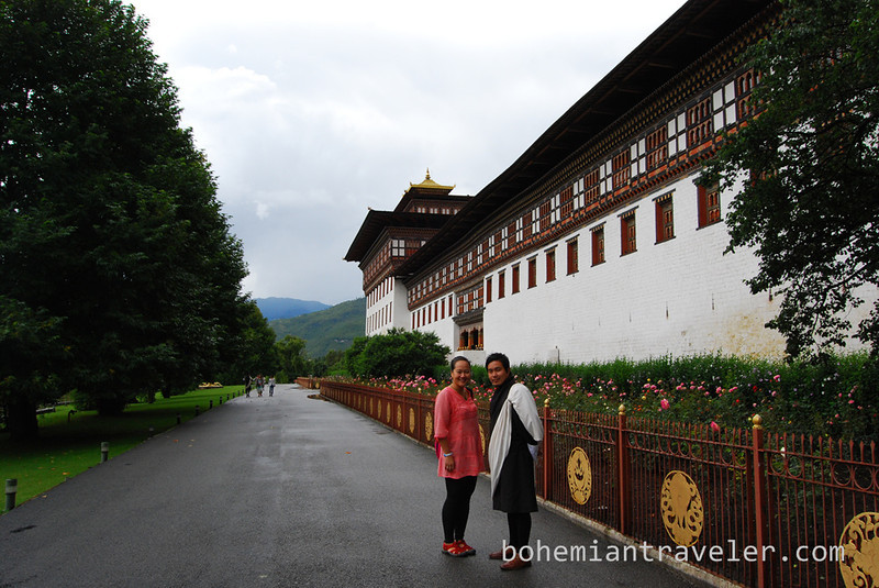 Juno and Tim outside Tashichho Dzong in Thimphu Bhutan.jpg