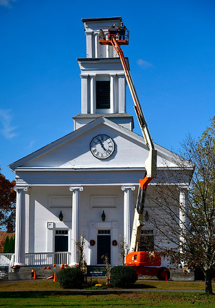 10/15/2019 Mike Orazzi | StaffrWorking being done on the steeple at the Plymouth Congregational Church on the town green Tuesday morning.