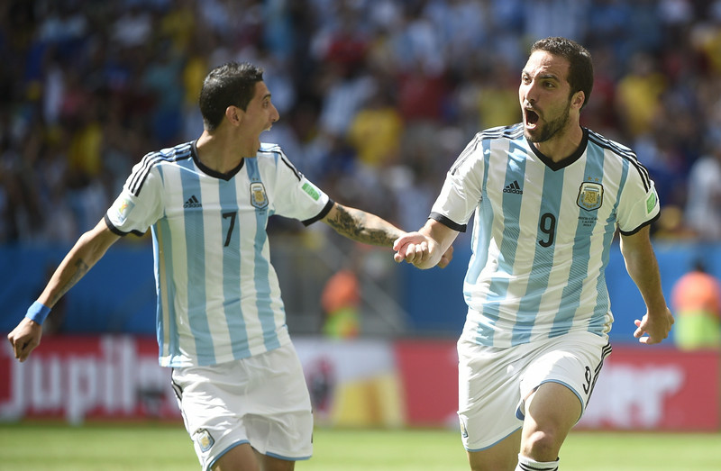 . Argentina\'s forward Gonzalo Higuain (R) celebrates with Argentina\'s midfielder Angel Di Maria (L) after scoring during a quarter-final football match between Argentina and Belgium at the Mane Garrincha National Stadium in Brasilia during the 2014 FIFA World Cup on July 5, 2014.   (MARTIN BUREAU/AFP/Getty Images)