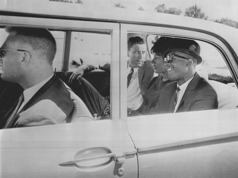 . James Hood, right, and Vivian Malone sit in a car with government officials as they are escorted to the campus at the University of Alabama in Tuscaloosa for an attempt to integrate the university. 1963 (The Denver Post Archive)