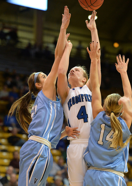 . Broomfield\'s Callie Kaiser goes to the basket between Valor Christian\'s MaKenna Roth and Sara Gibson during the final four 4A state game at Coors Event Center. (David R. Jennings/Broomfield Enterprise)