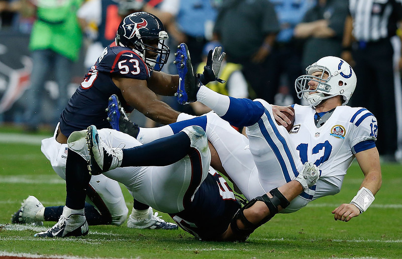 . Andrew Luck #12 of the Indianapolis Colts is sacked by J.J. Watt #99 and Bradie James #53 of the Houston Texans in the first half of the game at Reliant Stadium on December 16, 2012 in Houston, Texas.  (Photo by Scott Halleran/Getty Images)