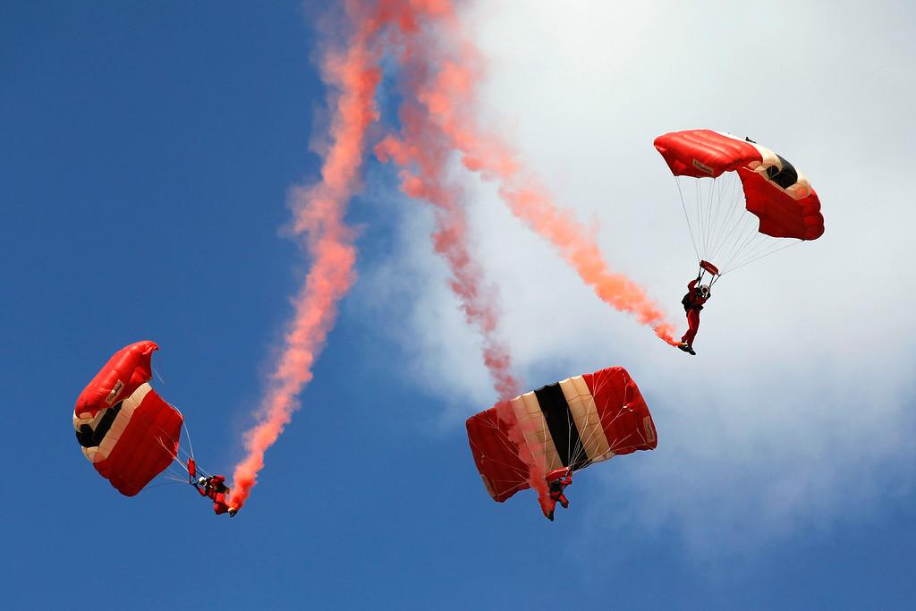 . The British Army\'s Parachute Regiment display team, the Red Devils, perform during the Farnborough International Air Show, Farnborough, England, Tuesday, July 15, 2014. (AP Photo/Sang Tan)