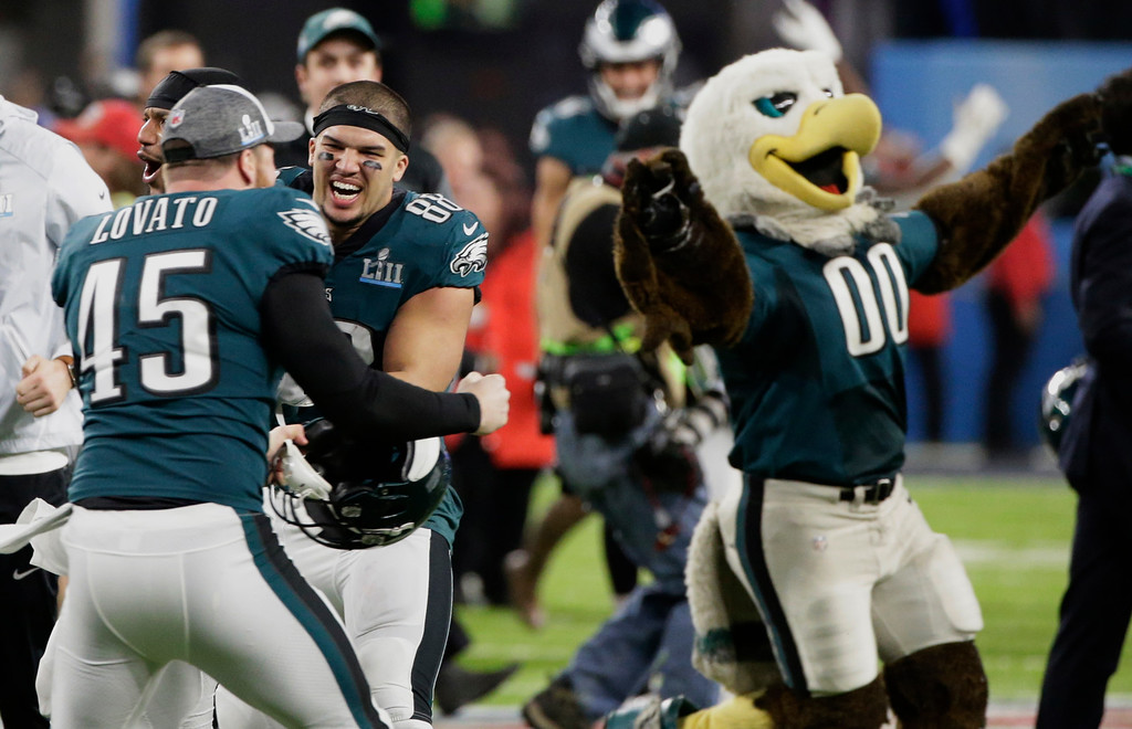 . Philadelphia Eagles long snapper Rick Lovato (45) and tight end Trey Burton (88) celebrate after winning the NFL Super Bowl 52 football game against the New England Patriots Sunday, Feb. 4, 2018, in Minneapolis. The Eagles won 41-33. (AP Photo/Frank Franklin II)