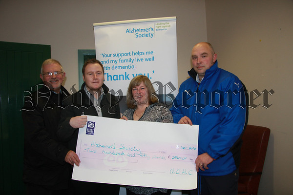 Cheque presented to Alzheimers by Newry Hockey Club