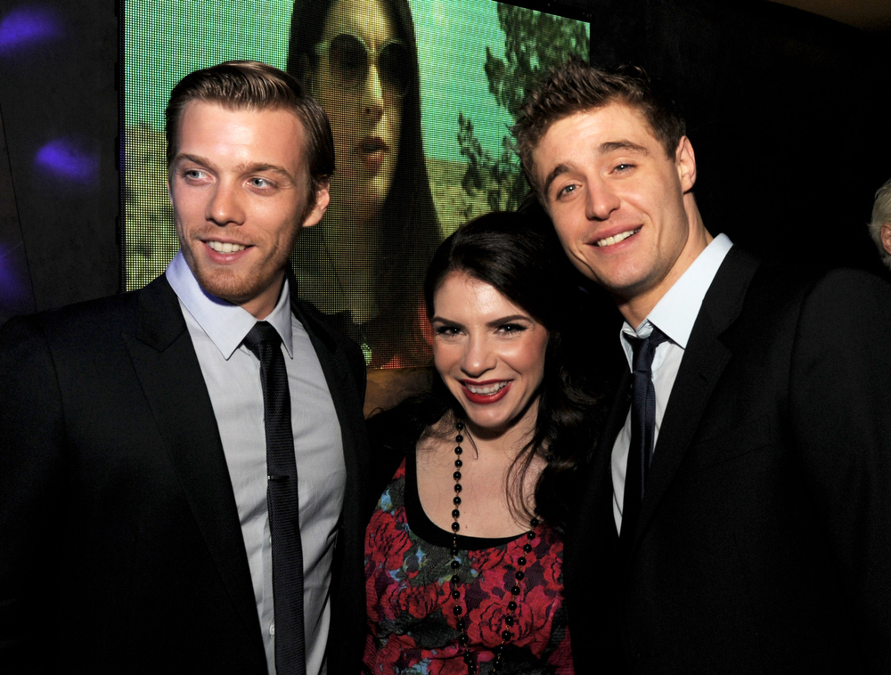 """. Actor Jake Abel, writer/producer Stephenie Meyer and actor and Max Irons pose at the after party for the premiere of Open Road Films\' \""""The Host\"""" at Lure on March 19, 2013 in Los Angeles, California.  (Photo by Kevin Winter/Getty Images)"""