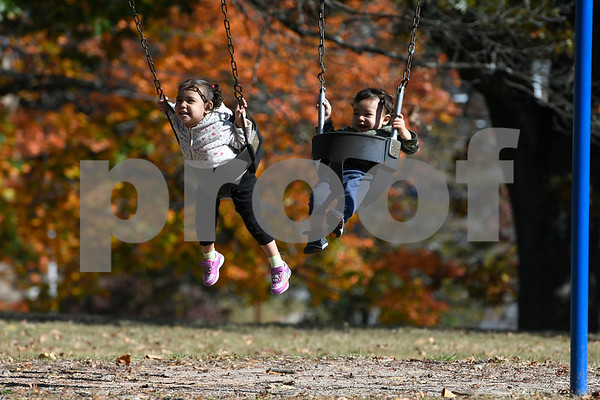 10/27/2017 Mike Orazzi | Staff Esmeralda and Benjamin Donovan Morales with their dad Benjamin on the Federal Hill Green in Bristol Friday afternoon.