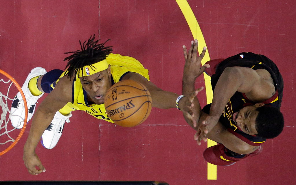. Cleveland Cavaliers\' Tristan Thompson, right, shoots over Indiana Pacers\' Myles Turner in the first half of Game 7 of an NBA basketball first-round playoff series, Sunday, April 29, 2018, in Cleveland. (AP Photo/Tony Dejak)