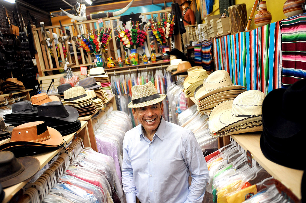 . Mayor Antonio Villaraigosa tries on a hat while visiting Olvera Street in Los Angeles, CA June 28, 2013.  Villaraigosa spent the day visiting some of his favorite loactions during his 24-hour goodbye tour.(Andy Holzman/Los Angeles Daily News)