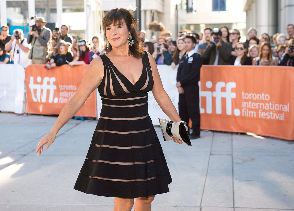 """. Cathy Jones poses for a photograph on the red carpet at the gala for the new movie \""""The Grand Seduction\"""" during the 2013 Toronto International Film Festival in Toronto on Sunday, Sept. 8, 2013.  (AP Photo/The Canadian Press, Nathan Denette)"""