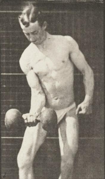 Man in pelvis cloth lifting weights