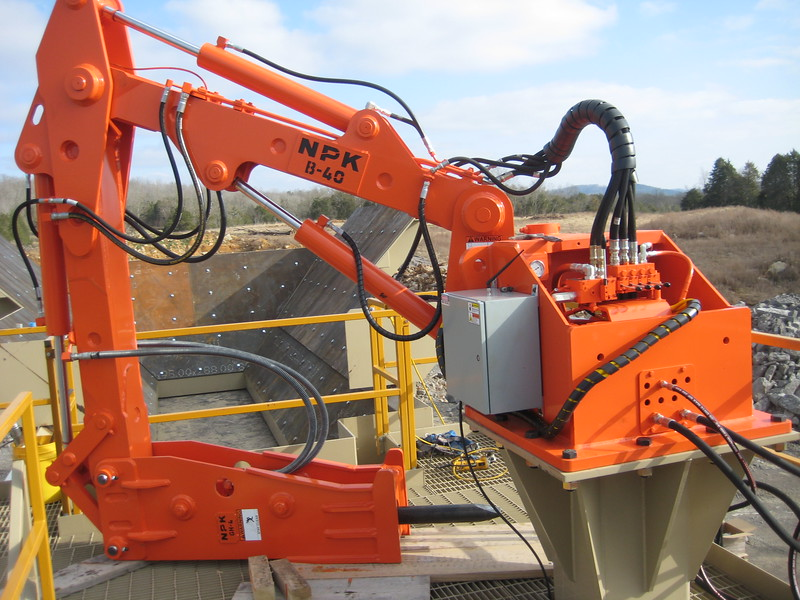 NPK B040 pedestal boom system with GH4 hydraulic hammer-breaking bridged rock in quarry (1).jpg