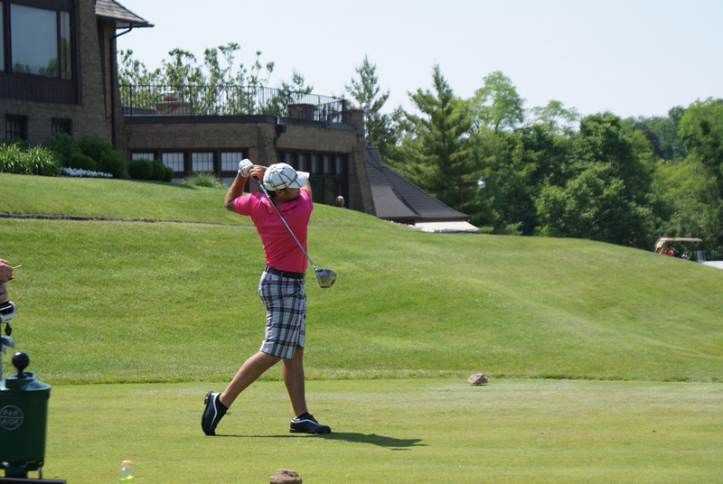 Nic Mazze, professional from Caledon, Ontario, Canada, tees off on the par 4 10th at Springfield CC.