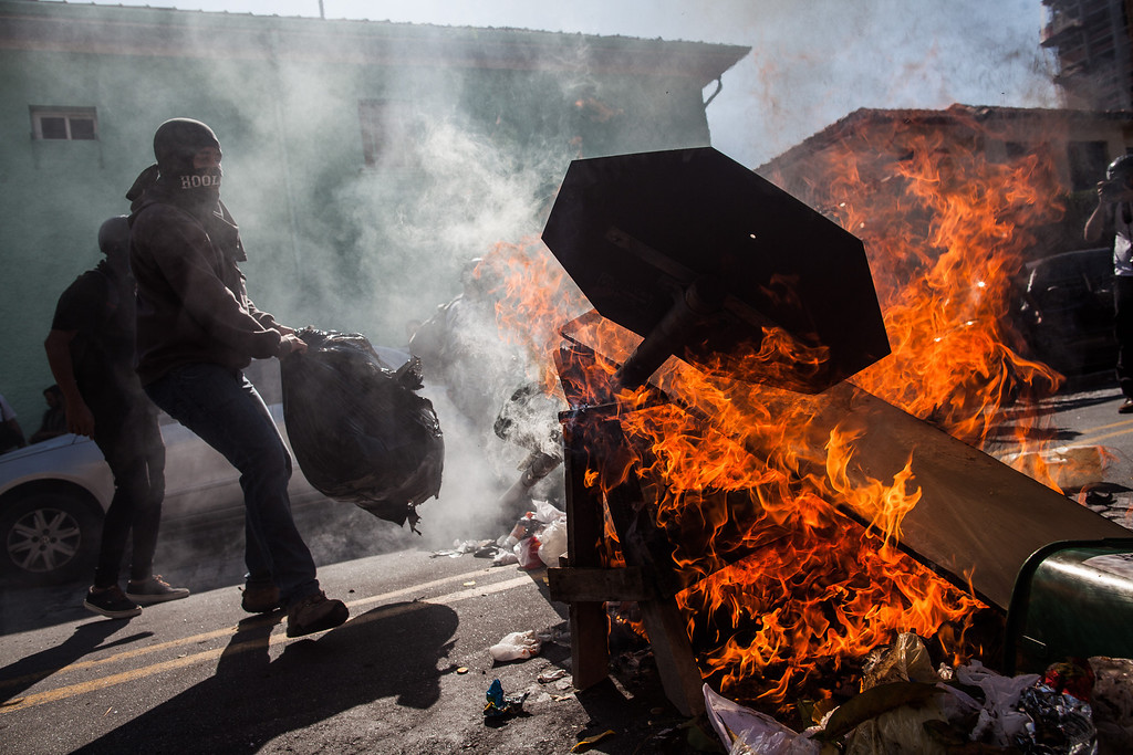 . Demonstrators from the anarchist group Black Bloc clash with police during a protest against the holding of the World Cup on the opening day of the event on June 12, 2014 in Sao Paulo, Brazil. (Photo by Victor Moriyama/Getty Images)