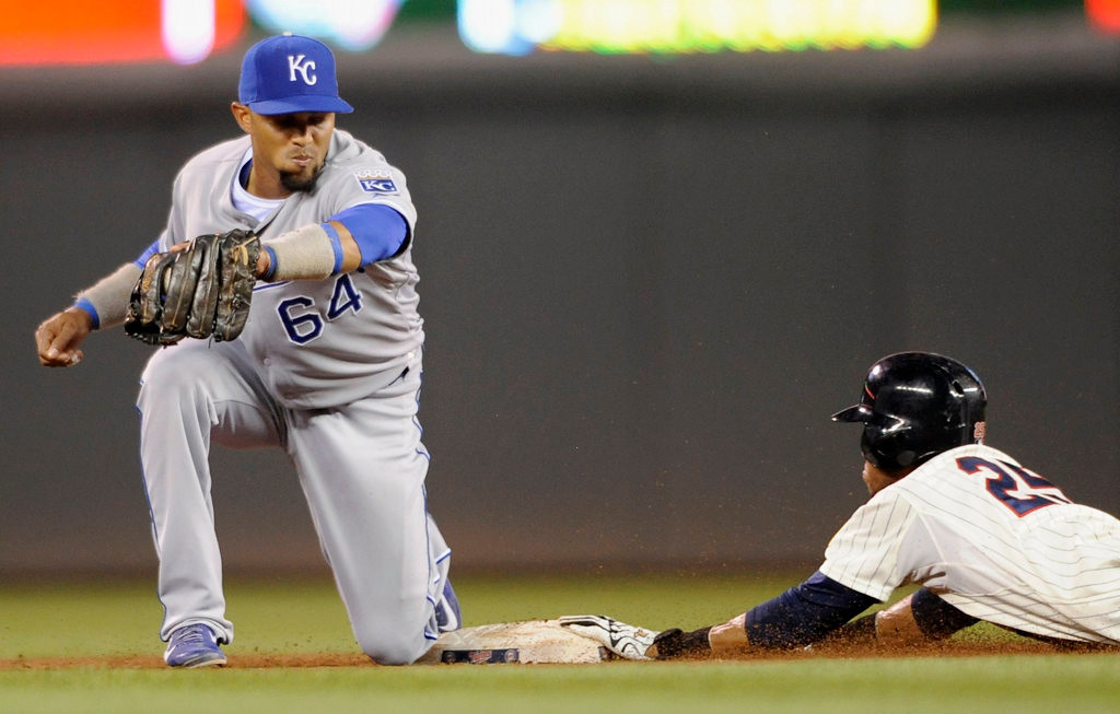 . Pedro Florimon #25 of the Minnesota Twins steals second base as Emilio Bonifacio #64 of the Kansas City Royals fields the ball during the sixth inning. (Photo by Hannah Foslien/Getty Images)