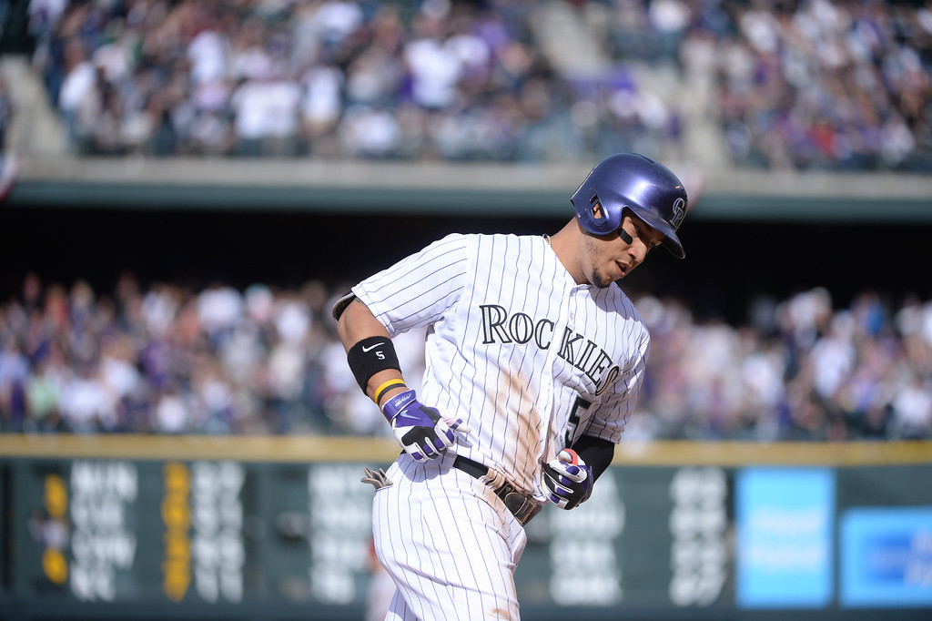 . Carlos Gonzalez rounds the bases after hitting a home run in the sixth inning. The Colorado Rockies hosted the Arizona Diamondbacks in the Rockies season home opener at Coors Field in Denver, Colorado Friday, April 4, 2014. (Photo by Karl Gehring/The Denver Post)