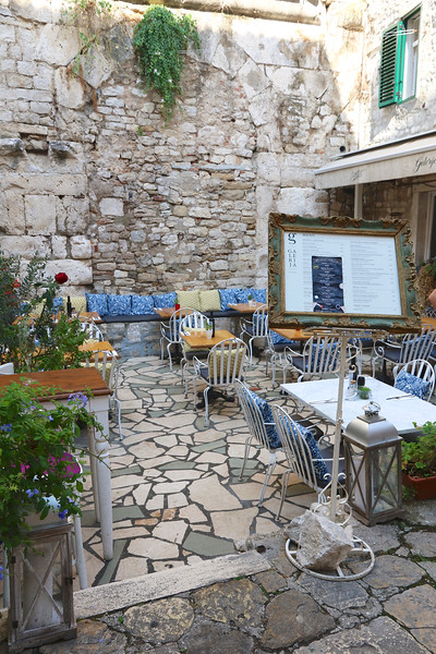 Another cafe built right into the ruins of Diocletian's Palace...can you say ambiance? — Old City, Split, Croatia.