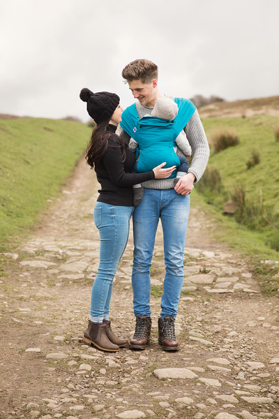 Izmi_Baby_Carrier_Cotton_Teal_Lifestyle_Front_Carry_Couple_Looking_At_Each_Other.jpg
