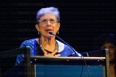 Louise Chernin, president and CEO of the Greater Seattle Business Association, speaks after receiving the Lifetime Achievement Award at the Puget Sound Business Journal's The Business Of Pride event at the Paramount Theatre in Seattle on Thursday, May 26, 2016. (BUSINESS JOURNAL PHOTO | Dan DeLong)