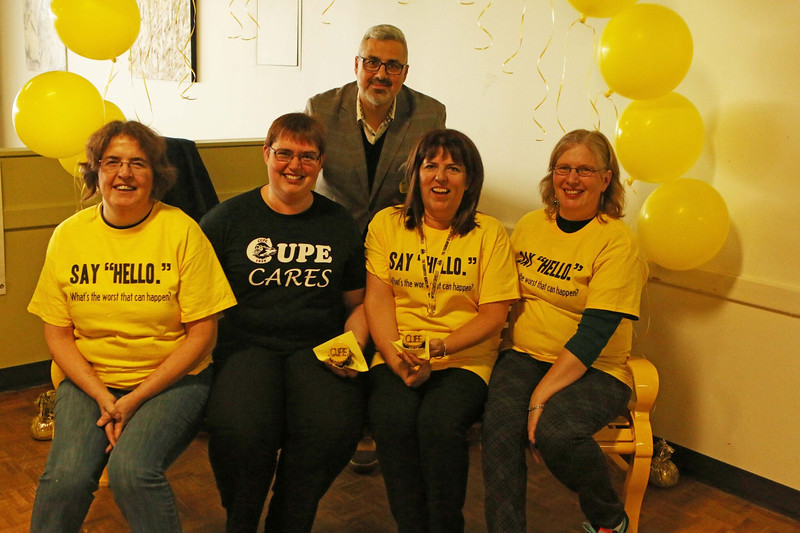 Sam Fiorella with CUPE 1858 members sitting on friendhip bench.jpeg