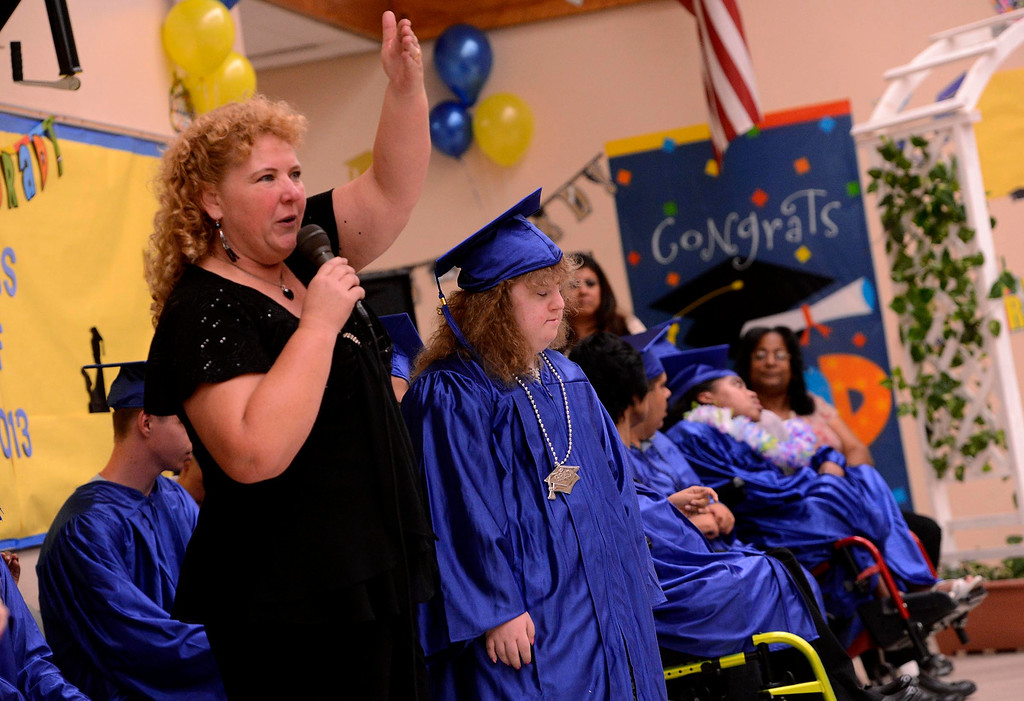 . Instructor Julie Chesney speaks about her student Anastasia Shreve during Commencement Ceremonies at Carl And Dora Anderson School in San Bernardino May 21, 2013.  GABRIEL LUIS ACOSTA/STAFF PHOTOGRAPHER.