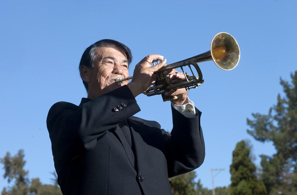 . Kenneth Weir plays taps at Santa Cruz Memorial in Santa Cruz, Calif., on Thursday, May 23, 2013. (Patrick Tehan/Bay Area News Group)
