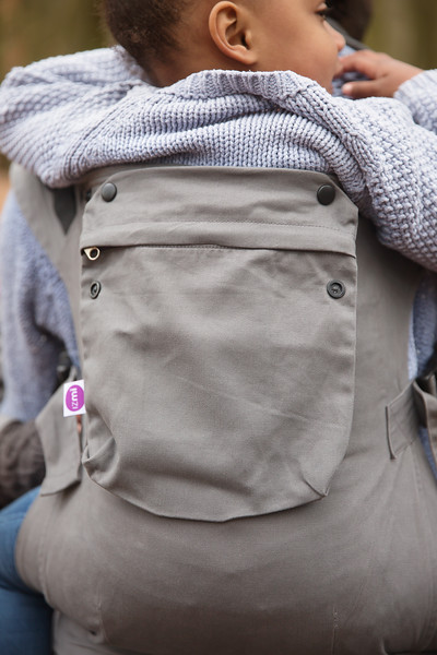 Izmi_Accessories_Lifestyle_Pocket_Mid_Grey_On_Mid_Grey_Toddler_Carrier_Back_Carry.jpg