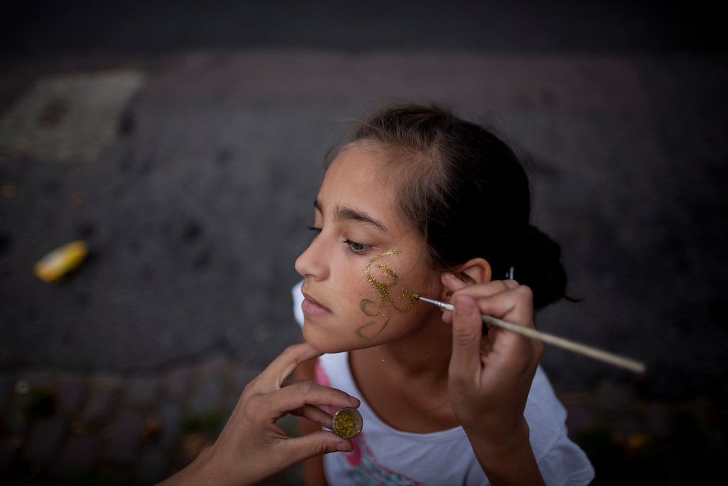 ". Sol Basualdo, a member of the murga ""Los amantes de La Boca,\"" has her makeup done in preparation for carnival celebrations in Buenos Aires, Argentina, Saturday, Feb. 2, 2013. Members of the murga \""Los amantes de La Boca\"" rehearse before participating in carnival celebrations in Buenos Aires, Argentina, Saturday, Feb. 2, 2013. Argentinians\' carnival celebrations may not be as well-known as the ones in neighboring Uruguay and Brazil, but residents of the nation\'s capital are equally passionate about their \'murgas,\' or traditional musical troupes. The murga \""Los amantes de La Boca\"" or \""The Lovers of The Boca\"" is among the largest, with about 400 members. It\'s a reference to the hometown Boca Juniors, among the most popular soccer teams in Argentina and the world. (AP Photo/Natacha Pisarenko)"