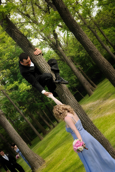 Robin Hood - The wedding was a few days ago but I am still processing the pics. This one is priceless; the best man climbing the tree. He did it spontaneously; next time I will ask for a volunteer!