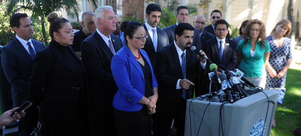 . City of Bell Gardens mayor Daniel Crespo, center, speaks during a press conference with concerned regional elected officials calling for Senator Ron Calderon to resign his position in the California State Senate in front of the Bell Gardens City Hall in Bell Gardens , Calif., on Wednesday, Nov. 13, 2013.   (Keith Birmingham Pasadena Star-News)