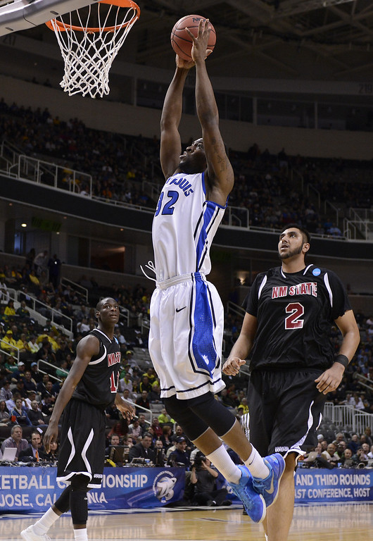 . Cory Remekun #32 of the Saint Louis Billikens goes up in front of Sim Bhullar #2 of the New Mexico State Aggies in the first half during the second round of the 2013 NCAA Men\'s Basketball Tournament at HP Pavilion on March 21, 2013 in San Jose, California.  (Photo by Thearon W. Henderson/Getty Images)