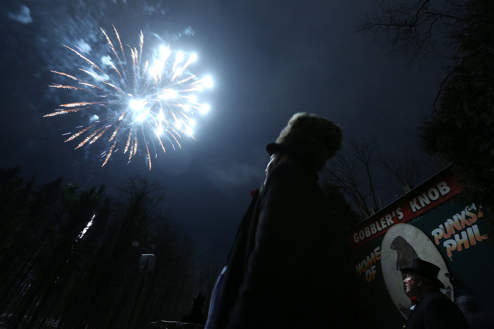 Description of . Fireworks are seen during the 127th Groundhog Day Celebration at Gobbler's Knob on February 2, 2013 in Punxsutawney, Pennsylvania. The Punxsutawney 'Inner Circle' claimed that there were about 35,000 people gathered at the event to watch Phil's annual forecast.  (Photo by Alex Wong/Getty Images)