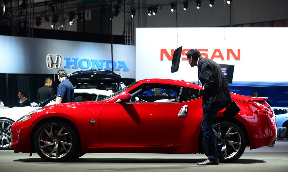 . A man checks out the Nissan 370z displayed on media preview day at the Los Angeles Auto Show on November 28, 2012 in Los Angeles, California. The show opens to the public from November 30 to December 9. AFP PHOTO / Frederic J. BROWN/AFP/Getty Images
