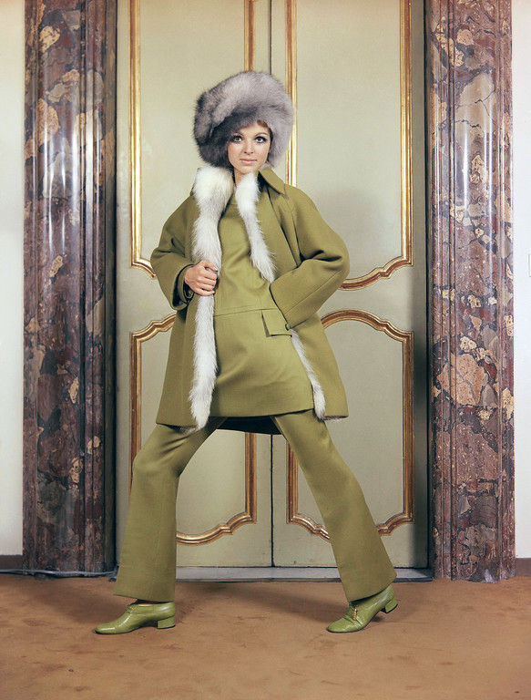 . A green woolen coat, trimmed with fox, worn with a green woolen dress and long pants, green shoes and a hat of fox fur, a creation by the Fabiani fashion house of Rome, presented at the Italian fall and winter fashion shows that opened in Rome. Undated photo.  (AP Photo)