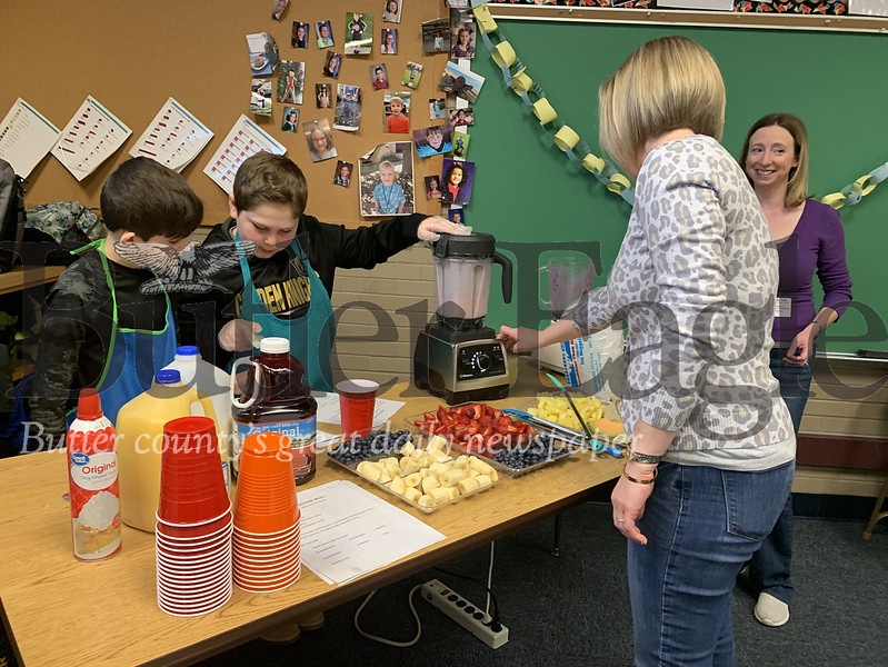 Third graders George Shattahi (left) and Zeke Fagan blend fruit for smoothies at their breakfast with cops event Wednesday morning. Photos by Alexandria Mansfield.