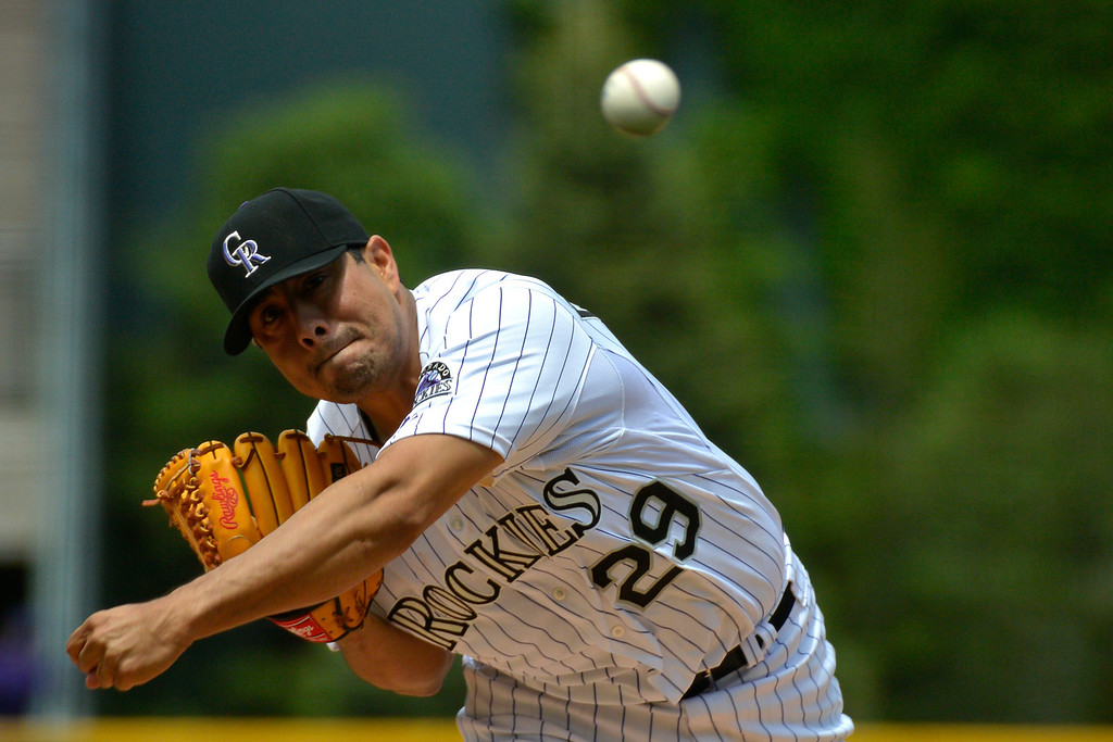. DENVER, CO - MAY 22: Colorado Rockies starting pitcher Jorge De La Rosa (29) delivers a pitch during the first inning against the San Francisco May 22, 2014 at Coors Field. (Photo by John Leyba/The Denver Post)