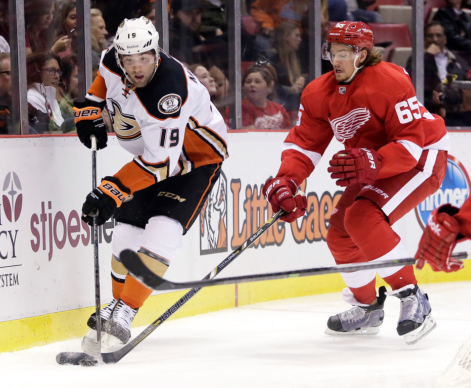 . Detroit Red Wings\' Danny DeKeyser (65) steals the puck from Anaheim Ducks\' Patrick Maroon (19) during the first period of an NHL hockey games Saturday, Oct. 11, 2014, in Detroit. (AP Photo/Duane Burleson)