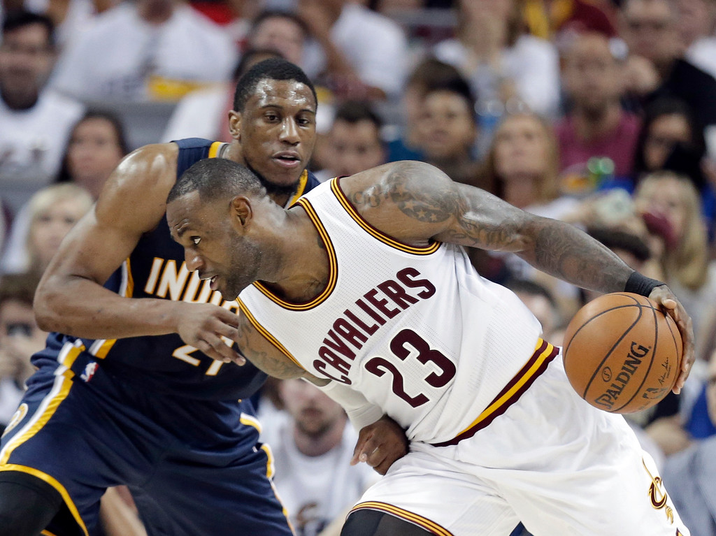 . Cleveland Cavaliers\' LeBron James (23) drives past Indiana Pacers\' Thaddeus Young (21) in the second half in Game 1 of a first-round NBA basketball playoff series, Saturday, April 15, 2017, in Cleveland. The Cavaliers won 109-108. (AP Photo/Tony Dejak)