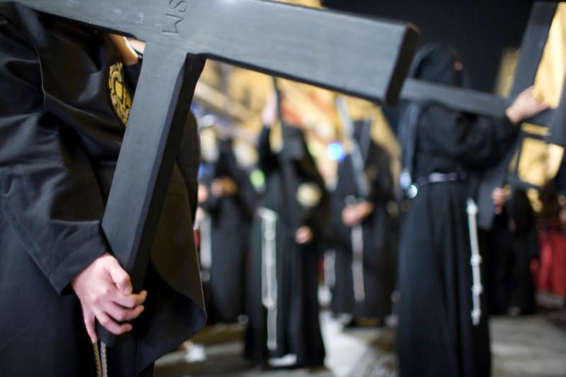 Penitents bearing wooden crosses, Holy Week 2008, Seville, Spain