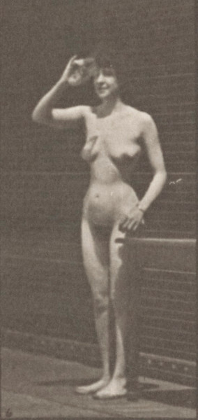 Nude woman drinking from a goblet while standing