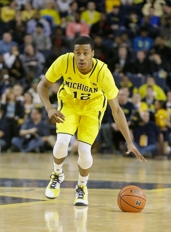. Michigan guard Muhammad-Ali Abdur-Rahkman controls the ball during the first half of an NCAA college basketball game against Ohio State, Sunday, Feb. 22, 2015 in Ann Arbor, Mich.  (AP Photo/Carlos Osorio)